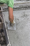 Concrete leveling with trowel Royalty Free Stock Photography