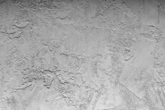 Concrete light gray wall with cracks. Background with texture. Stock Images