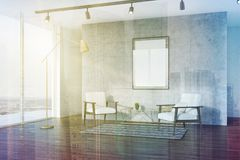 Concrete living room, white armchairs, side toned. Side view of a loft living room interior with concrete walls, a wooden floor, two white armchairs and a framed Royalty Free Stock Photo