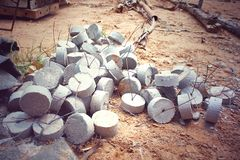 Concrete lumps on the ground. Small pieces of cement for spacing the concrete covering floor. At construction site Stock Photos