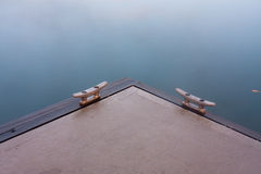 Concrete marine pontoon on still water Stock Photos