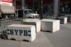 Concrete and metal NYPD street barricades on a Manhattan New York street near a police station. New York, NY - April 3, 2019: Concrete and metal NYPD street royalty free stock photo