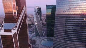 Movie style footage of business center. Modern architecture. Moscow city Russia from above. Downtown. Glass reflections. Concrete and metal. Unique Aerial drone stock footage