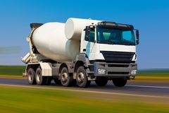 Concrete mixer. On the road with motion blur effect Royalty Free Stock Photos