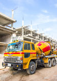 Concrete mixer car_1. Mobile concrete mixer car on building construction site Royalty Free Stock Images