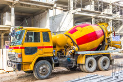 Concrete mixer car_2. Mobile concrete mixer car on building construction site Royalty Free Stock Photography