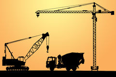 Concrete mixer and cranes Stock Photo