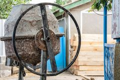 Concrete mixer machine. At construction site close-up royalty free stock photography