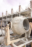 Concrete mixer machine. Old concrete mixer machine on building construction site Royalty Free Stock Photos