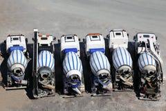 Concrete mixer machines stand on asphalt Stock Photo