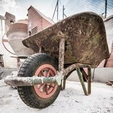 Concrete mixer. Old handcart and concrete mixer Stock Photography