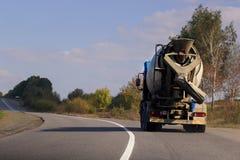 Cement Mixer Truck. Concrete mixer rides along the road stock images