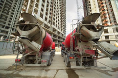 Concrete mixer stand near unfinished building Stock Image