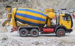Concrete mixer truck on construction site. Closeup Stock Images