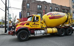 Concrete Mixer Truck. A concrete mixer truck drives along a Brooklyn street on November 11, 2015 in New York City, USA Stock Images