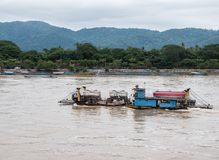 Concrete mixer truck on the ferry boat. Concrete mixer truck on the ferry boat for crossing the large river,northern of Thailand royalty free stock images