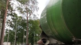 Concrete Mixer Truck. Green color works mixes cement on building construction site in the pine forest in slow motion camera movement stock video