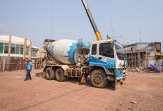 Concrete mixer truck parked at construction site Stock Image