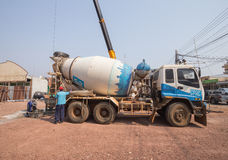Concrete mixer truck parked at construction site Royalty Free Stock Photos
