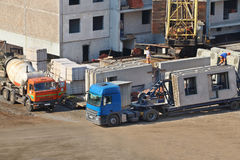 Concrete mixer, truck, workers on construction site Royalty Free Stock Images