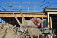 Concrete mixer and wheelbarrow Stock Images