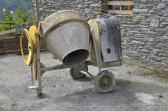 Concrete mixer. In a workplace. Construction machinery for mixing cement Royalty Free Stock Photos
