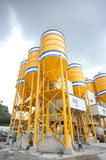 Concrete mixing plant. Large yellow concrete mixing plant background sky royalty free stock photography