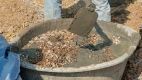 Concrete mixing step of sand cement and water by construction in construction. Concrete mixing step of sand cement and water by construction stock photos