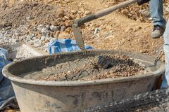 Concrete mixing step of sand cement and water by construction in construction. Concrete mixing step of sand cement and water by construction royalty free stock images