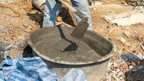 Concrete mixing step of sand cement and water by construction. In construction site stock images