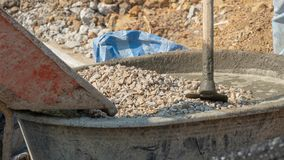 Concrete mixing step of sand cement and water by construction in construction. Concrete mixing step of sand cement and water by construction royalty free stock photography