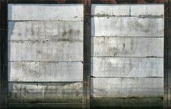 Concrete mooring wall texture. Abstract texture of an old concrete mooring wall with black rusted metal framing Royalty Free Stock Photos