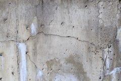 Concrete muur er is een barst daarin Textuur overtreden bouwtechnologie stock afbeeldingen