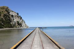 Concrete Narrow Pathway Under Body of Water Near Rock Formation Under Clear Blue Sky Royalty Free Stock Images
