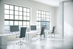 Concrete office with city view. Coworking office interior with computers, concrete floor, walls, columns and windows with city view. 3D Rendering Royalty Free Stock Photos