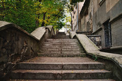 Concrete old steps in city. Old concrete stairs leading up to the city Stock Images