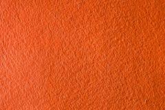 Concrete oranje textuurachtergrond Royalty-vrije Stock Foto's