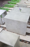 Concrete outdoor furniture set in the small garden Stock Photography