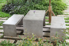 Concrete outdoor furniture set in the small garden Royalty Free Stock Photo