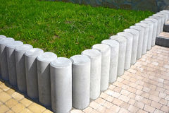 Concrete palisade and pavement Stock Photography