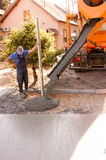 Concrete parking places. Workers work on concreting parking spaces in front of the house. Mason worker leveling concrete with trowels mason hands spreading Stock Photos