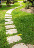 Concrete path on green grass Royalty Free Stock Images