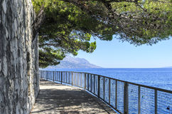 Concrete path by the sea. Photographed in the summer royalty free stock photos