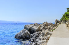 Concrete path by the sea. Photographed in the summer royalty free stock photography
