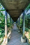 Pathway in the park. Concrete pathway and metal structure with green trees in the park Stock Photography