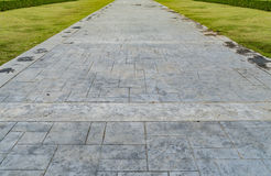 Concrete pathway in the park Stock Photo