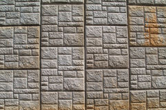 Concrete Patterned Retaining Wall along a highway. Concrete, weather stained, pressed patterned, retaining wall along a highway Stock Photos