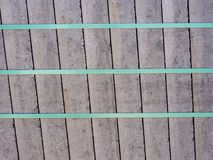 Concrete paving slabs bundled and secured with plastic strap. Concrete paving slabs bundled and secured with plastic strap on Euro palett stock image