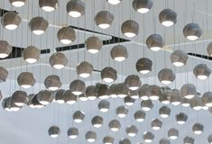 Concrete pendant lamp.  Ceiling dotted with many concrete pendant lights. Concrete pendant lamp. Ceiling dotted with many small concrete pendant lights Royalty Free Stock Image