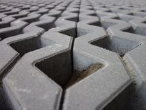 Concrete permeable grid pavers, close-up. Retaining wall made of permeable reinforced concrete units. Lawn grid Royalty Free Stock Images